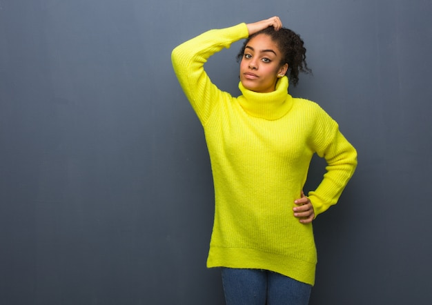 Young black woman worried and overwhelmed Premium Photo