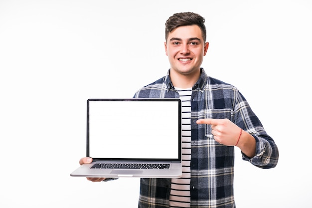 Young blackhaired man demonstrating something on bright laptop Free Photo