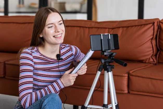 Young blogger recording herself with smartphone Free Photo