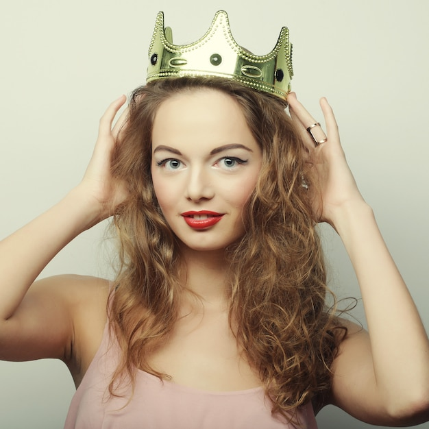 Young blond woman in crown Premium Photo
