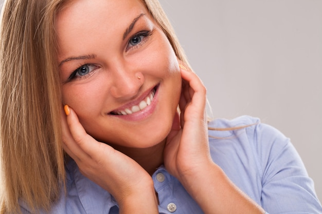 Young blond woman smiling Free Photo