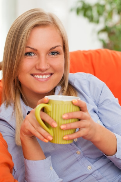 Young blond woman with mug Free Photo