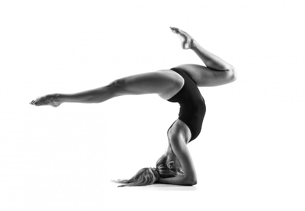 Young blonde woman in maillot practicing rhythmic gymnastics Premium Photo