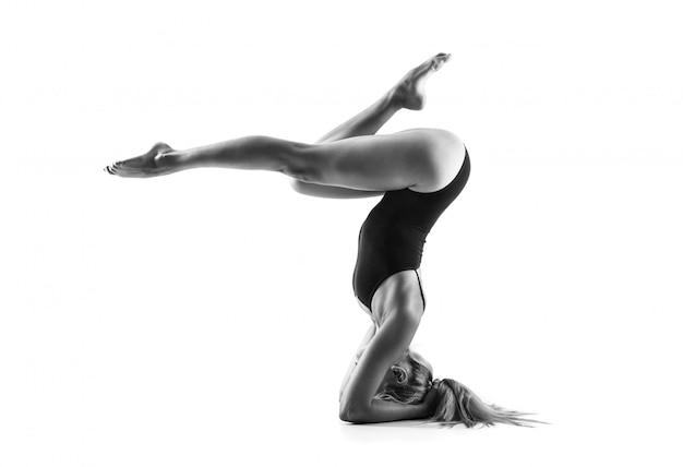 Young blonde woman in maillot practicing yoga lesson Premium Photo