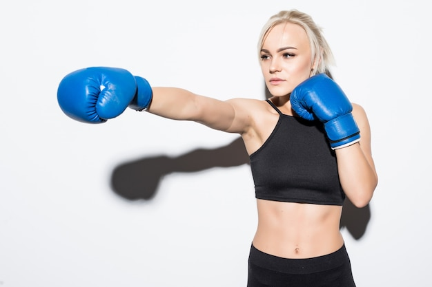 Young blonde woman with blue boxing gloves on white Free Photo
