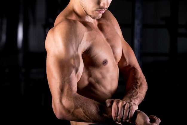 Young bodybuilder with muscular arms 1163 3563