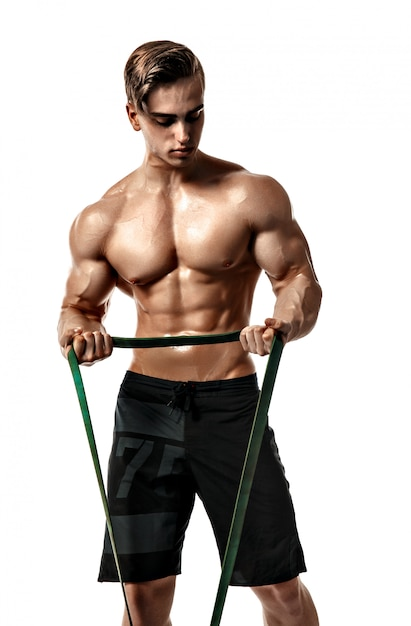 Young bodybuilder working out with rubber band over white background Premium Photo