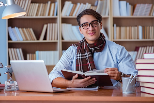 Young book writer writing in library Premium Photo