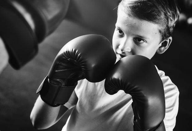 Young boy aspiring to become a boxer Free Photo