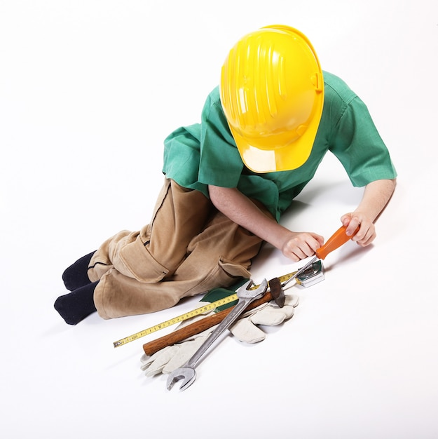 Young boy playing with tools for work Premium Photo