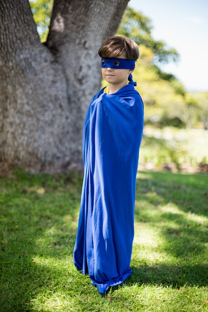 Young boy pretending to be a superhero Premium Photo
