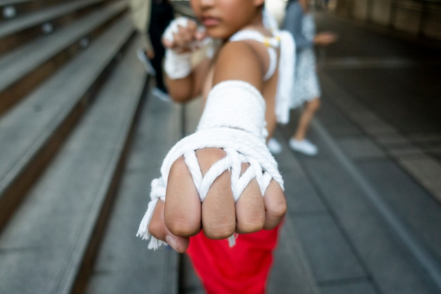 Young boy in thai tradition boxing Premium Photo
