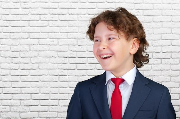 Young boy in tuxedo Premium Photo