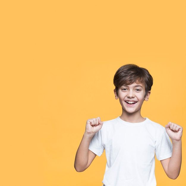 Young boy with fists closed Free Photo