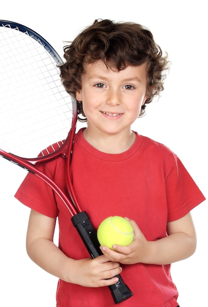 Young boy with tennis racket and ball Premium Photo