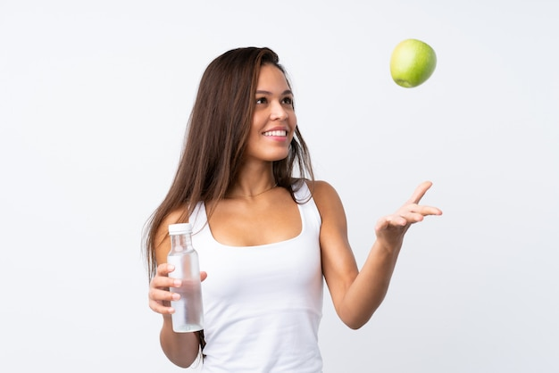 Young brazilian girl with an apple and with a bottle of water Premium Photo