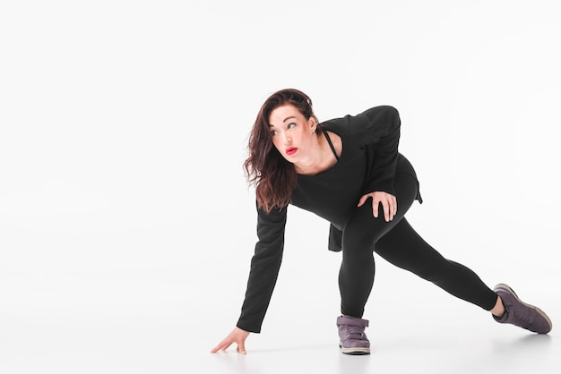 Young break dancer dancing over white background Free Photo