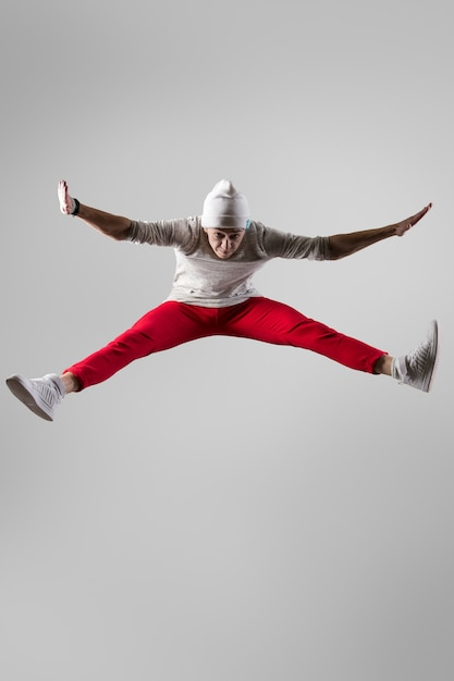 Young breakdancer jumping Free Photo