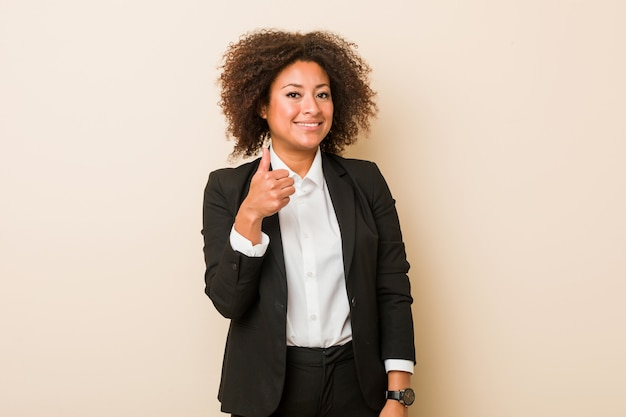 Young business african american woman smiling and raising thumb up Premium Photo