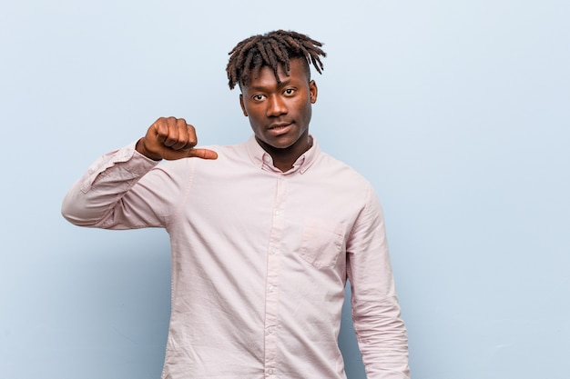 Young business african black man showing a dislike gesture, thumbs down. disagreement . Premium Photo