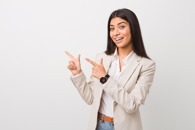 Young business arab woman isolated againstwhite  pointing with forefingersa , expressing excitement and desire. Premium Photo