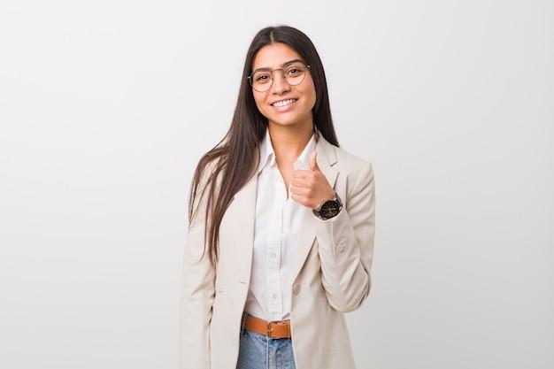 Young business arab woman smiling and raising thumb up Premium Photo