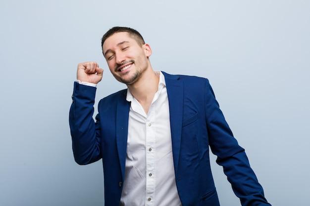 Young business caucasian man dancing and having fun. Premium Photo
