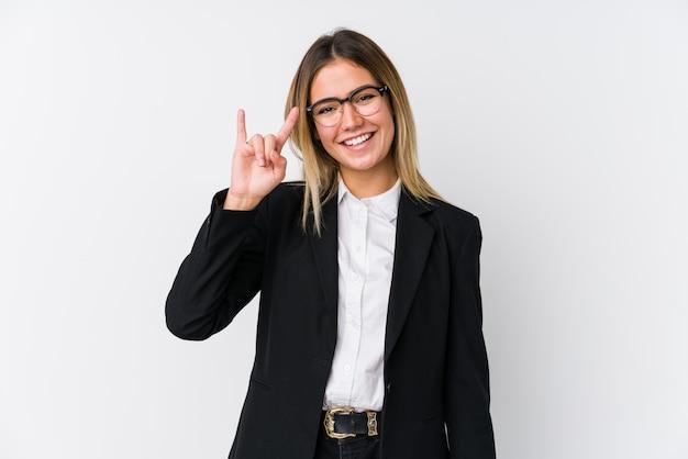 Young business caucasian woman showing a horns gesture as a revolution concept. Premium Photo