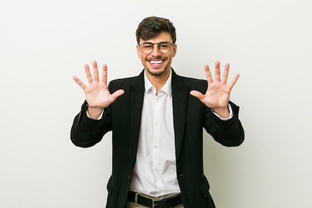 Young business hispanic man showing number ten with hands. Premium Photo