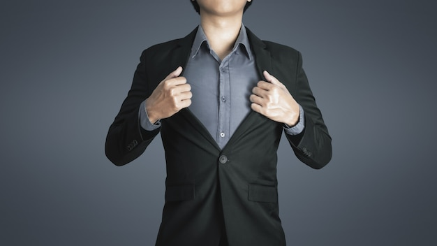 Young business man wears luxurious black suit with happy expression of success in work and good life. Premium Photo