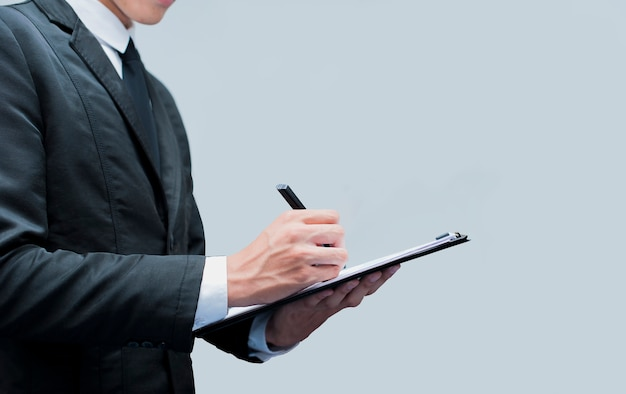 Young business man with the pen signing contract Premium Photo