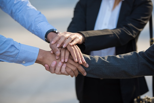 Young business people putting and join their hands together in stack. Premium Photo