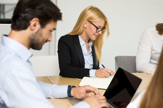 Young business people working in the office Premium Photo