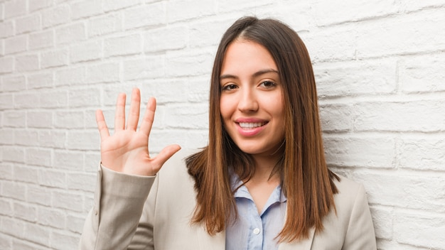 Young business woman showing number five Premium Photo