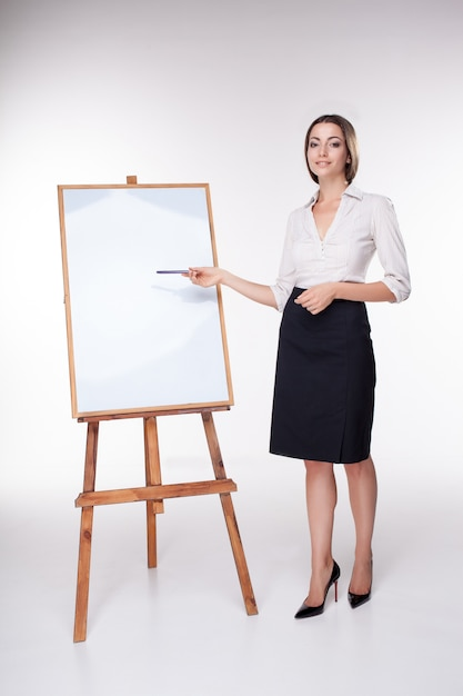 Young business woman showing something on white Free Photo