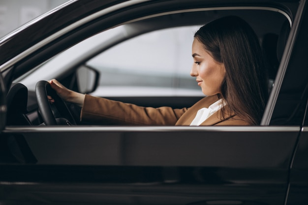 Young business woman sitting in car Free Photo