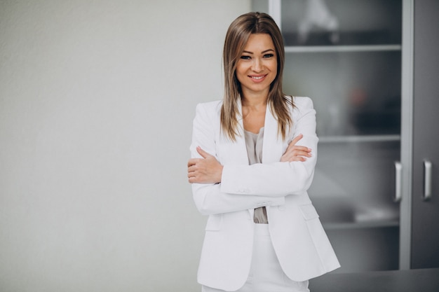 Young business woman standing in office Free Photo