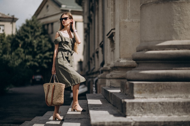 Young business woman walking up the stairs Free Photo