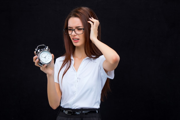 The young business woman with alarm clock Free Photo