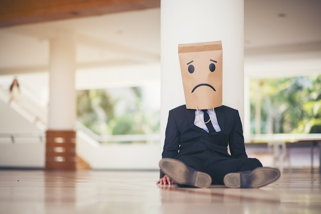 Young businessman crying abandoned lost in depression Premium Photo