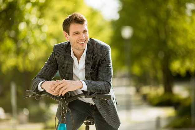Young businessman on the ebike Premium Photo
