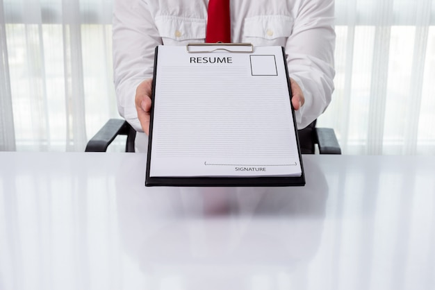 Young businessman giving a resume Premium Photo
