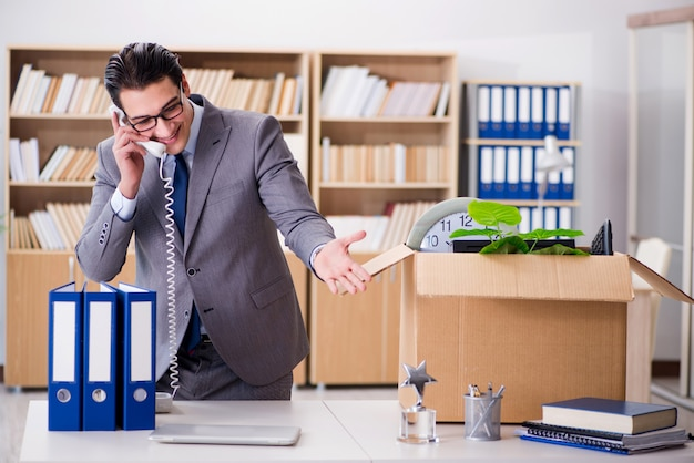 Young businessman moving offices after being made redundant Premium Photo
