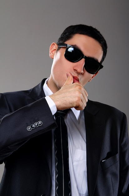 Young businessman in sunglasses Free Photo