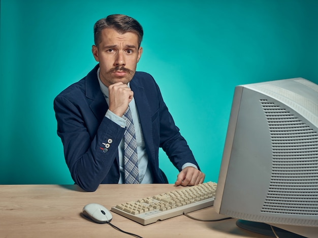 Young businessman using computer at the office Free Photo