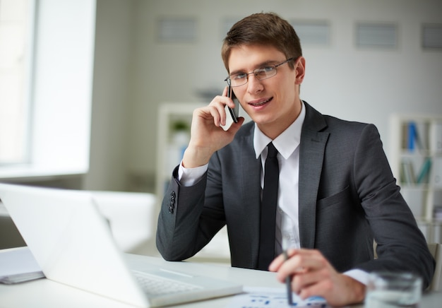 Young businessman very busy Photo | Free Download