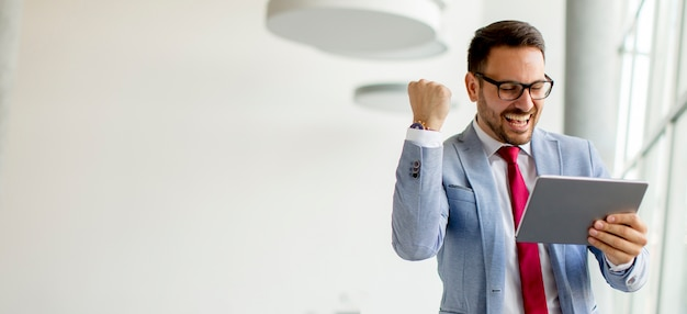Young businessman with digital tablet in office Premium Photo