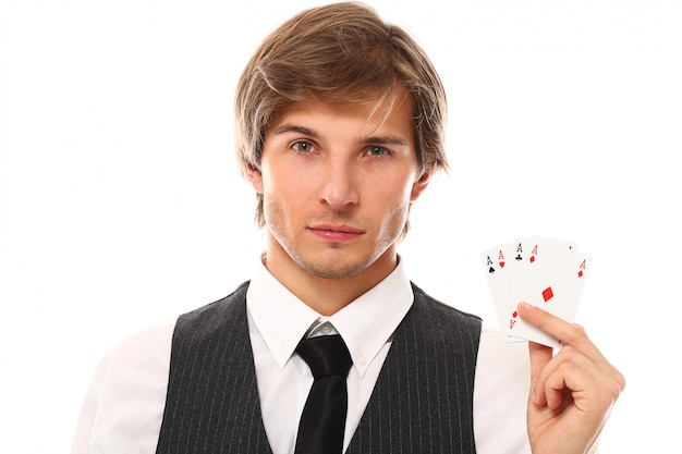 Young businessman with poker cards Free Photo