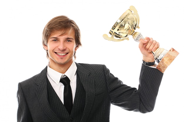 Young businessman with trophy Free Photo