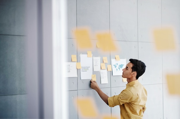 Young businessman working in office meeting room. concentrate on document note Premium Photo